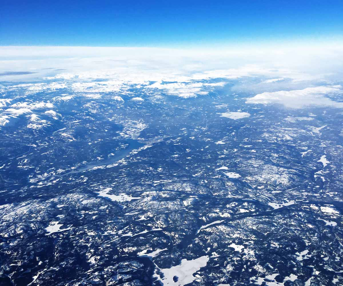 Approaching over a winter wonderland in Norway